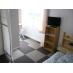 テレビ、冷蔵庫、エアコン付きの個室です